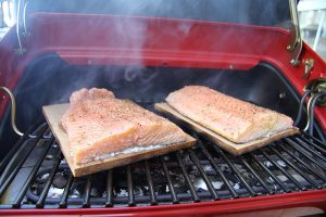 Searing fish on the Easy Street Electric Tabletop Grill with easy-view window and rotisseri